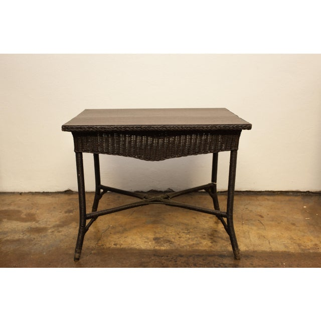 This antique wicker library/writing table was refinished in its original mahogany finish about 10 years ago. It has a...