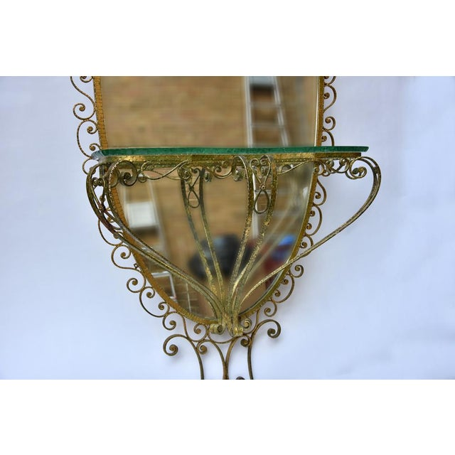 Gilt wrought iron tall oval mirror with a console designed and hand crafted school of Eugenio Colli,Made in Italy c.1940s...