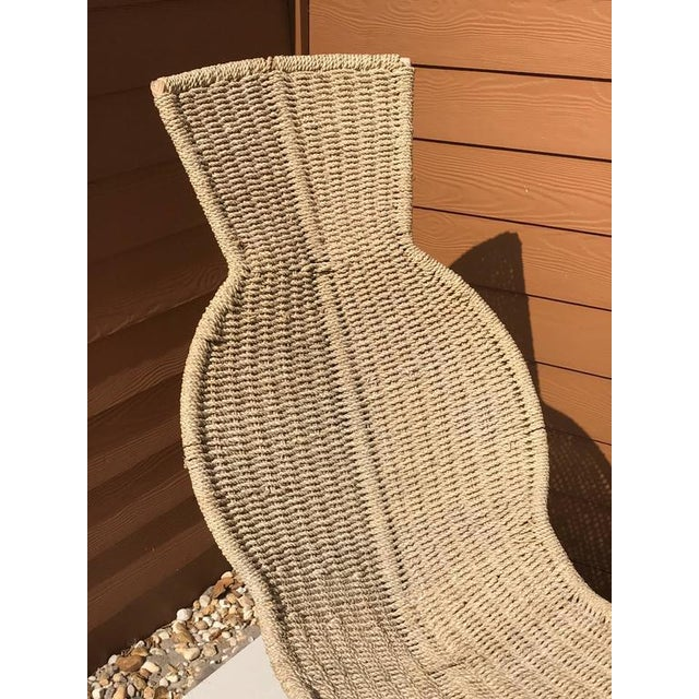 Sculptural woven rope chaise longue, rope and rattan woven on wrought iron base.