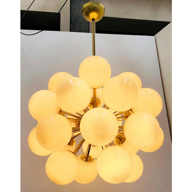 Italian chandelier shown in 24 gray Murano glass globes mounted on natural brass frame, designed by Fabio Bergomi / Made...