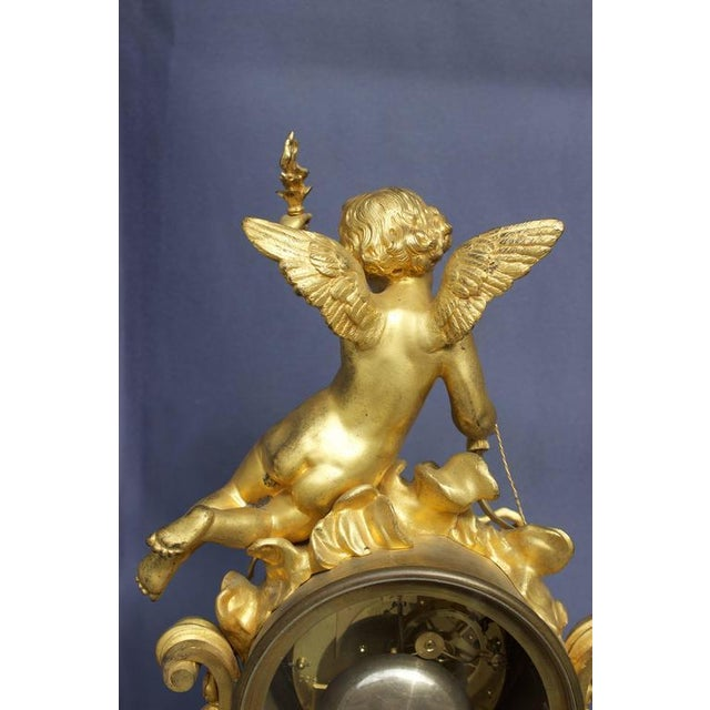 A superb mid-19th century. Clock with beautifully chased and ormolu gilded bronzes. Rest on a white Carrara marble base...