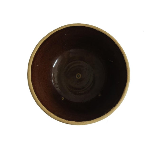 "Vintage small round brown stoneware bowl. Unmarked. Measures 7"" across the top and 3 1/2"" tall."