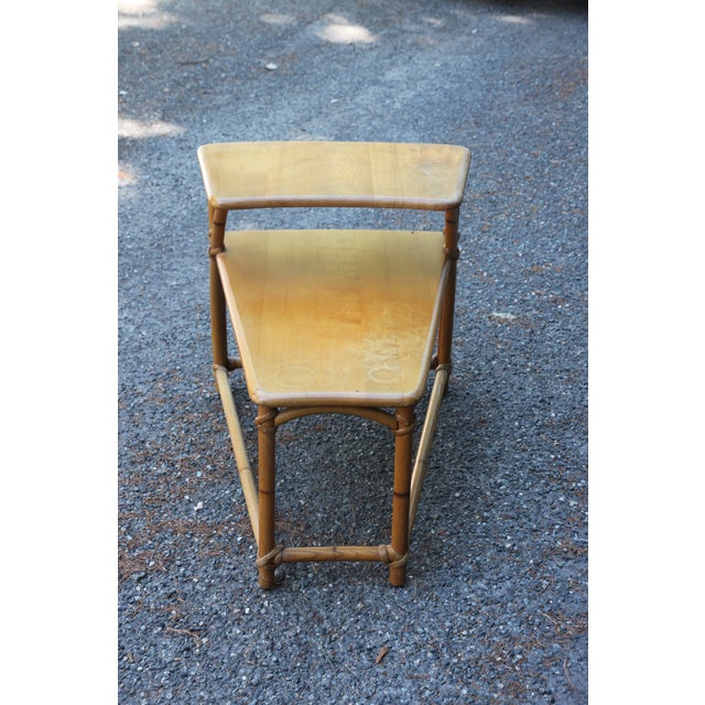 This is a small end table by Heywood-Wakefield made between the 50s -60s. The cane and table surface are both sound, but...