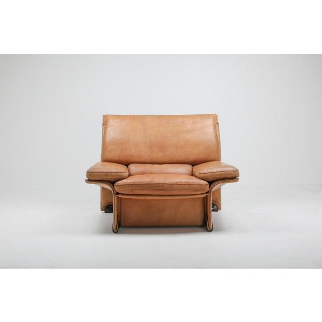Buffalo leather edition designed by Titiana Ammanati & Giampiero Vitelli in 1976 for Brunati, Italy. This pair of lounge...