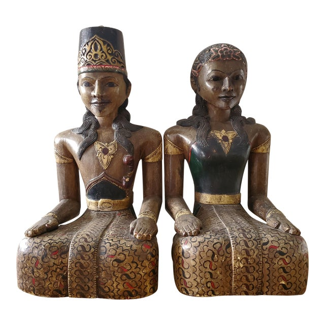 Indonesian Carved Wood Statues, a Pair For Sale