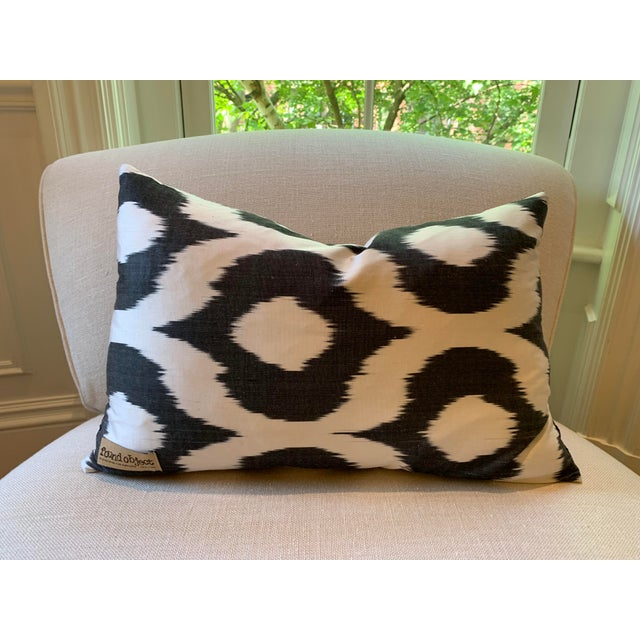 Velvet Ikat accent pillow in black and cream from Found Object. A great accent piece for any sofa or chair! Insert included.