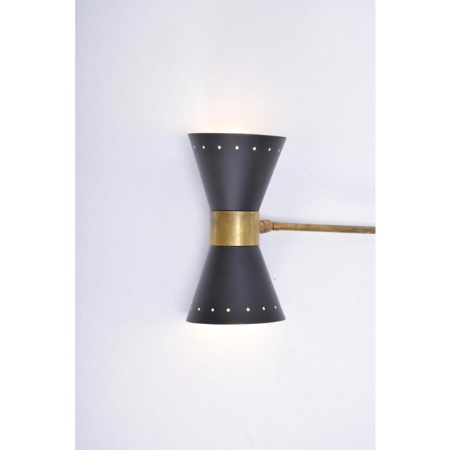 - Italian wall light with brass elements - Fully adjustable and rotatable - Each arm has a light for two E14 bulbs - This...