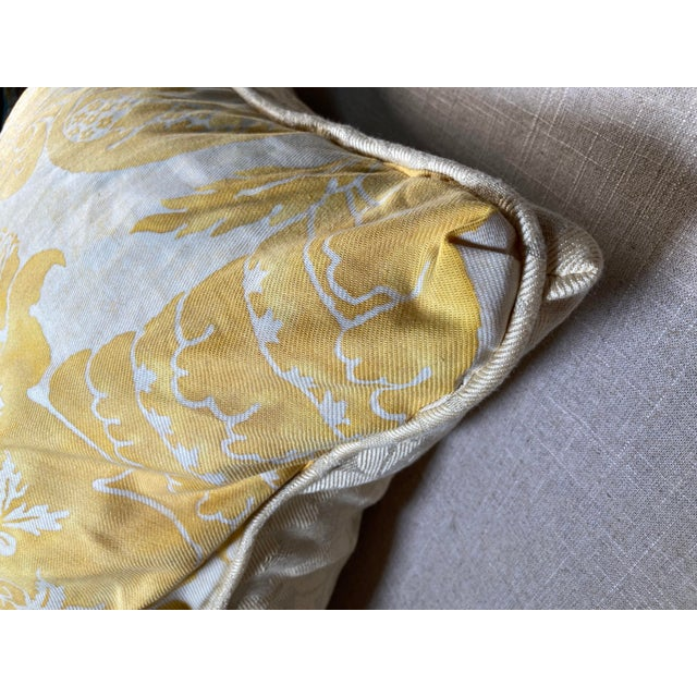 A pillow made from a circa 1980s Fortuny printed cotton backed with a coordinating linen damask, a down insert is...