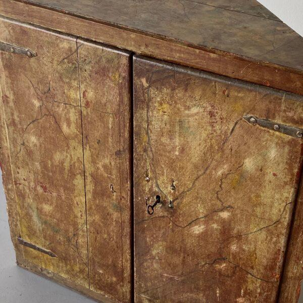 Antique painted corner cabinet with metal hinges. Height: 40 in Width: 39.5 in Depth: 18.75 in