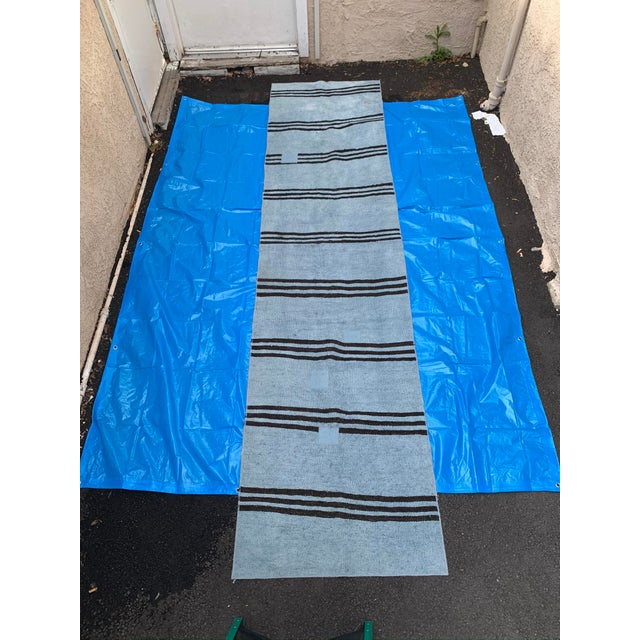 This vintage hemp runner originally made in Turkey has been hand dyed a robin's egg blue and accented with chocolate brown...