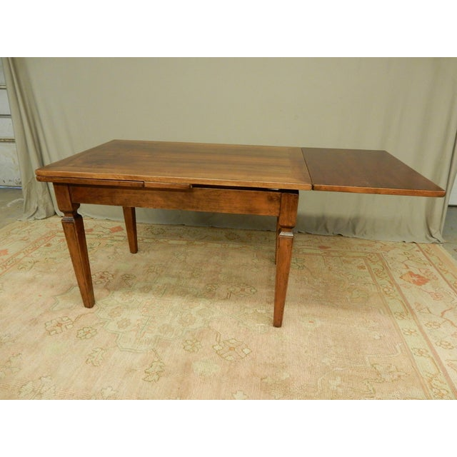 Antique Italian farm table with slideouts on either side. The table works with one or two of the sides extended out. The...