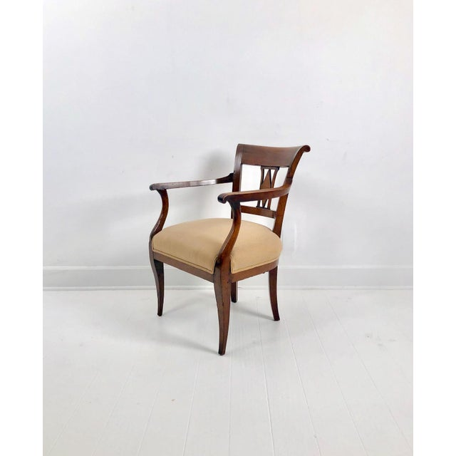 A pair of early 19th Century Neoclassical walnut armchairs, Italy circa 1830.