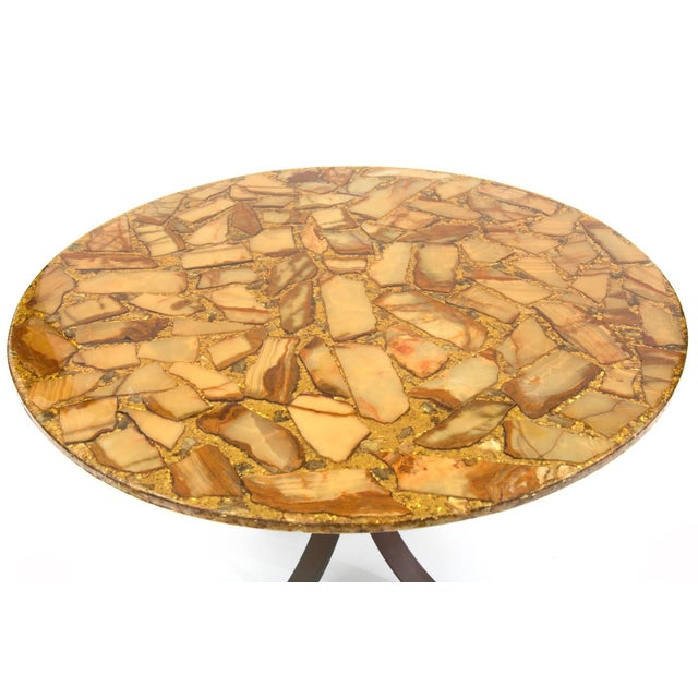 Cut agate and bronze dining table, circa late 1960s. The top of this example has beautifuly grained agate pieces and gold...