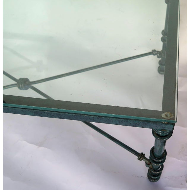 Diego Giacometti style heavy iron forged coffee table with the original mixed green patina. Bought at an estate sale in...