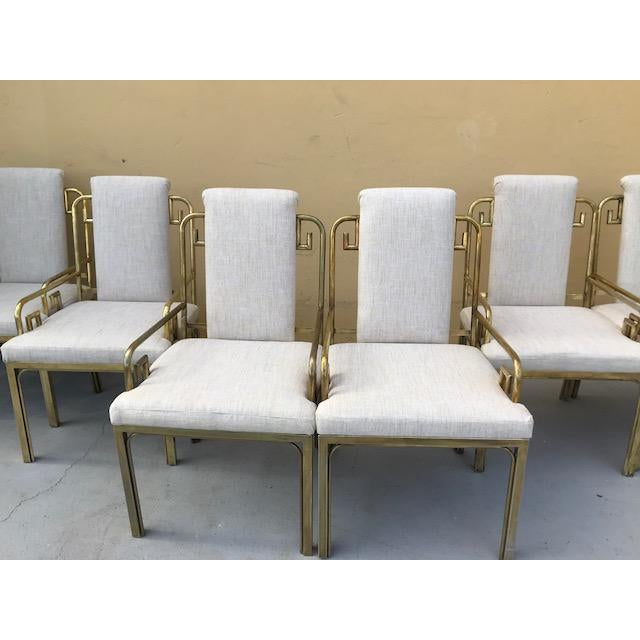An absolutely stunning set of six Mastercraft brass Greek key dining chairs newly upholstered in a luxurious Linen with a...