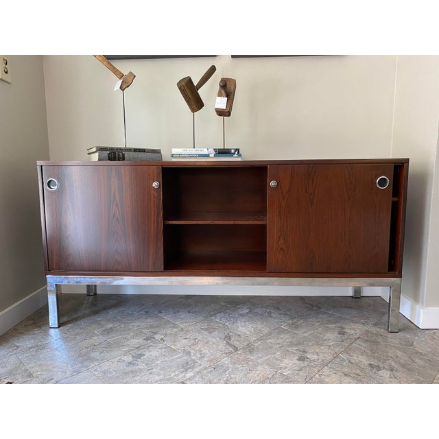 Stunning mid-century console with special key-shaped handle. From Italma and designed by Jean Gillon. restored to bring it...