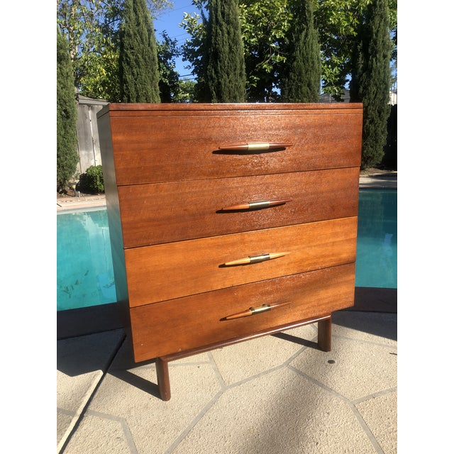 Amazing 1950s Brown Saltman Mahogany 4 drawer Highboy Dresser for sale. In good vintage condition with a few minor...