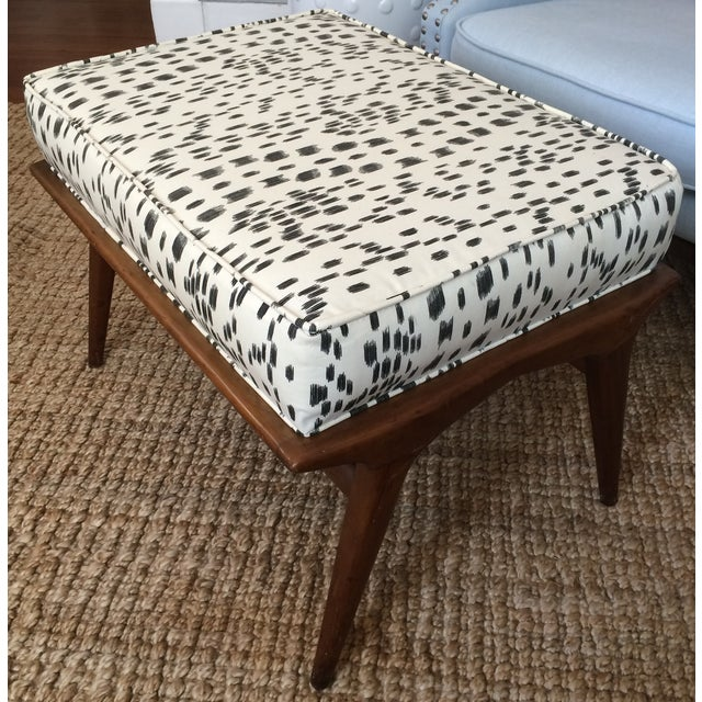 A sculptural ottoman with frame in walnut by Carlo de Carli for M. Singer & Sons, American 1950's. Upholstery fully...