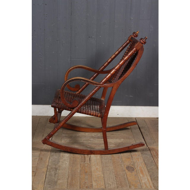 Campaign Hunzinger-Style Carved Wood and Woven Fabric Rocking Chair For Sale - Image 3 of 6