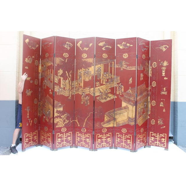 An Antique Grand Scale Traditional Asian 8 Panel Screen - Oxblood ground with 24k Gold Embellishment. Completely hand...