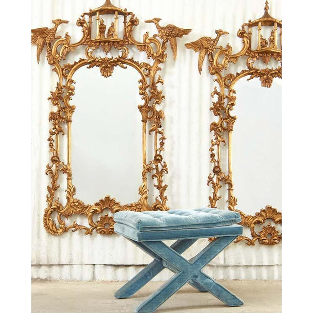 Stunning pair of large Chinese chippendale style pier or console mirrors. The gilt wood mirrors feature a pagoda top with...