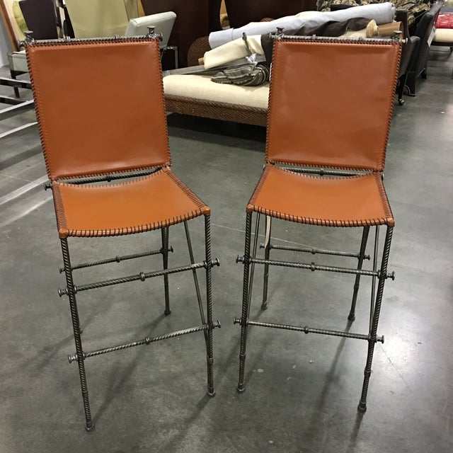 Pair of bar stools by Shadow Mountain. Made of rebar and 100% authentic leather. Refined look makes these bar stools great...