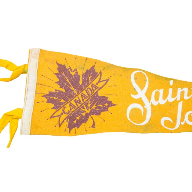 Charming and rare felt flag pennant of Saint John N.B. Canada, circa the 1940s, featuring a glittery banner overtop of...