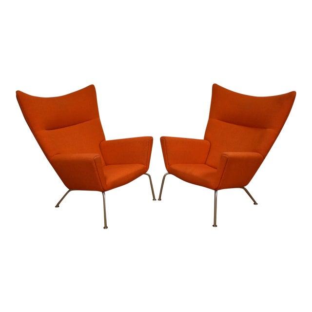 Hans J. Wegner CH445 Orange Lounge Chairs - a Pair For Sale