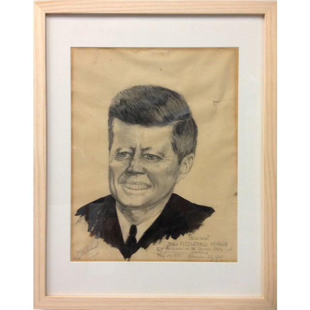 Framed vintage pencil portrait of John F. Kennedy, drawn by Lois Milchnett in 1965. A stilted, awkward, but lovingly hand-...