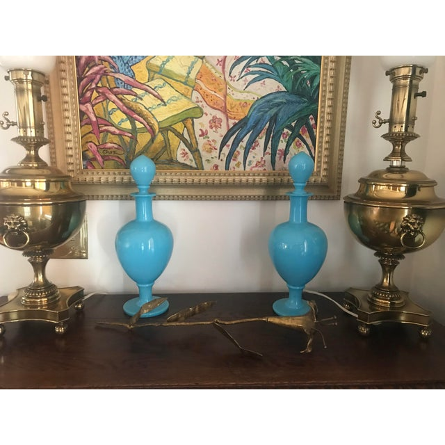 This incredible pair of decanters was made in France of a beautiful blue opaline glass. They were made during the late...