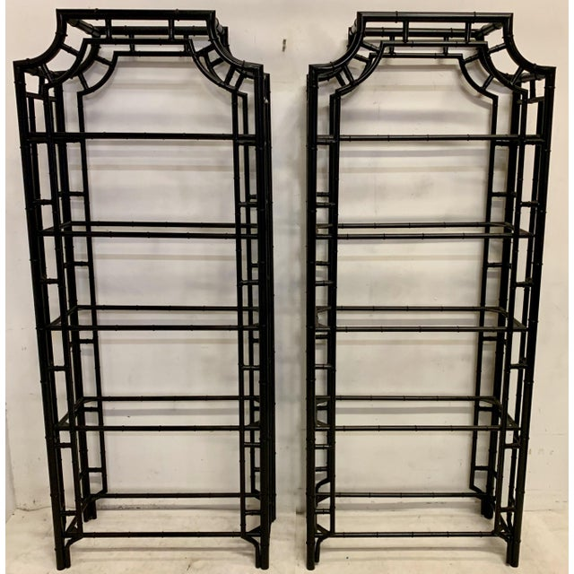 This is a vintage pair of cast aluminum faux bamboo etageres that have been given a fresh black lacquered finish. The most...
