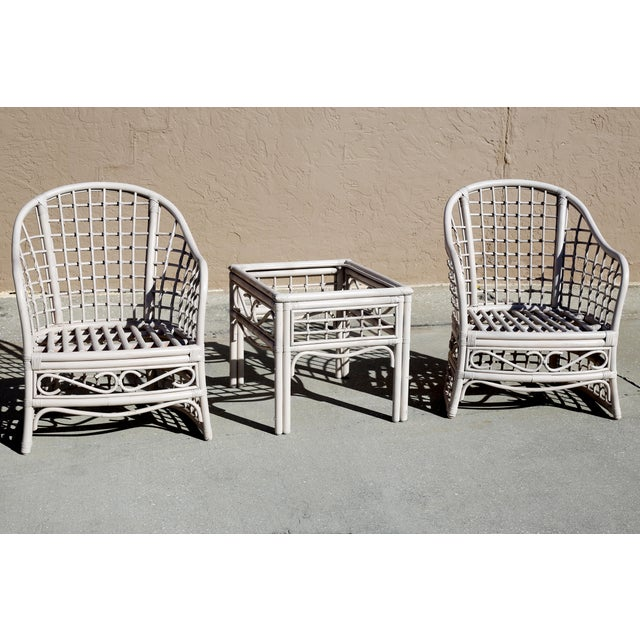 A vintage, rattan seating set, with two club chairs and matching side table. Very good vintage condition. No cushions or...