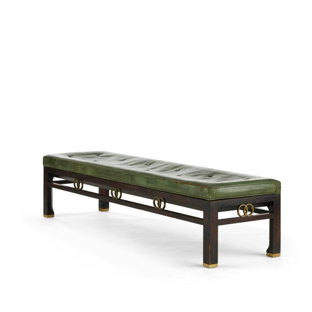 Vintage green leather, walnut, and brass upholstered bench designed by Michael Taylor for Baker Furniture. Circa 1960s...