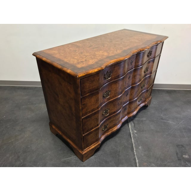 Stunning chest in burl wood with inlaid banded top and drawer fronts. Four drawers of dovetail construction with brass...