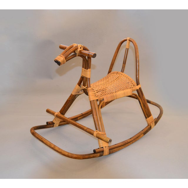 Mid-Century Modern Rattan and Bamboo Rocking Horse, Sculpture inspired by Franco Albini. Rattan and bamboo rocking horse...