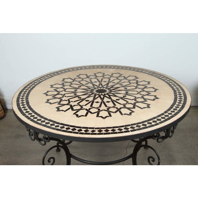 Handcrafted round Moroccan outdoor mosaic tile table 47 in. diameter on iron base. Classic and elegant Moroccan outdoor...