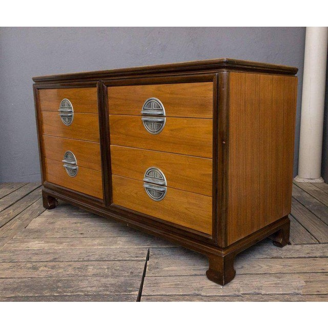 "American midcentury ""Chinese"" modern low chest of drawers in walnut with darker trim and pewter hardware. This piece is..."