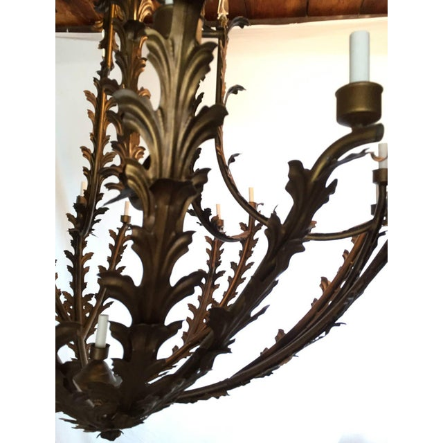 This huge chandelier is 68 inches wide and 63 inches high (without chain or canopy.) It has six arms, each with three...