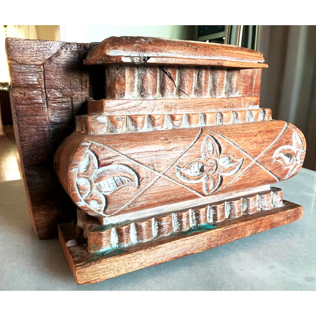 Anglo Indian Carved Light Teak Architectural Half Pillar Pilaster Capital Column Top from the early 20th C. This column...