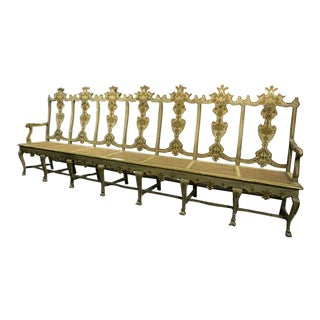 Italian Painted Long Settee With Shaped Back Splat and Cane Seats. Carved and Shaped Legs Culminating to Individual Single Stretchers. For Sale