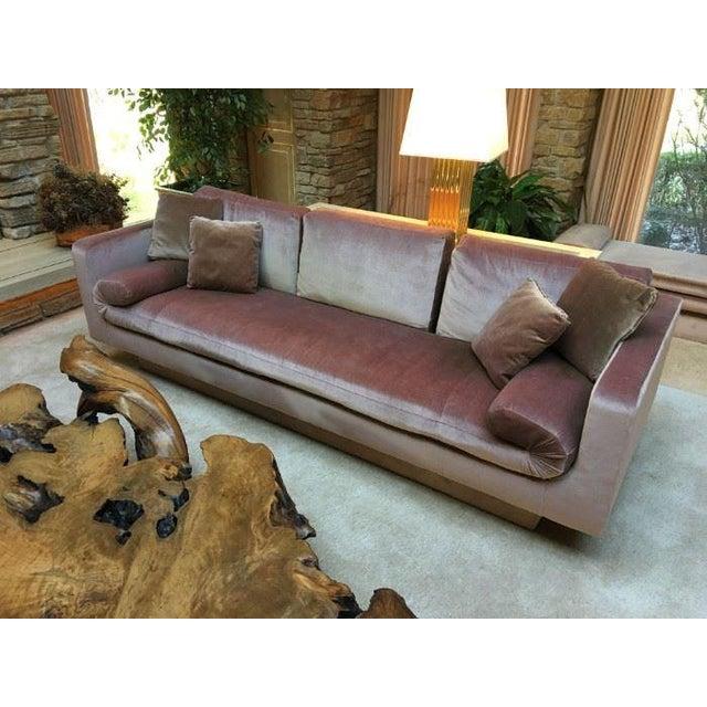 Exquisite vintage sofa from Baker Furniture upholstered in blush pink velvet. Striking, clean-lined modern form atop a...