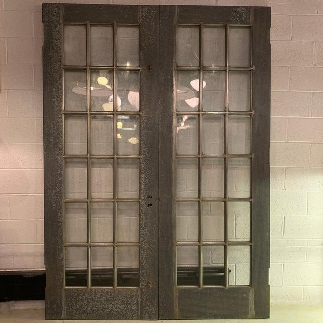 Pair of impressive, Industrial, 8 foot tall, architectural doors feature galvanized steel paned frames with wood cores,...