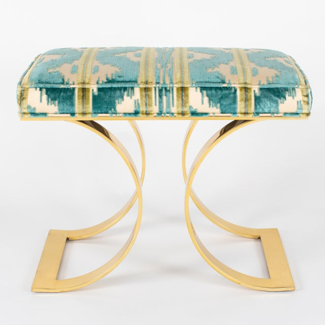 "This chic, iconic ""J.M.F. Curved Bench"" by Karl Springer is executed in solid brass with Brunschwig & Fils upholstery. The..."