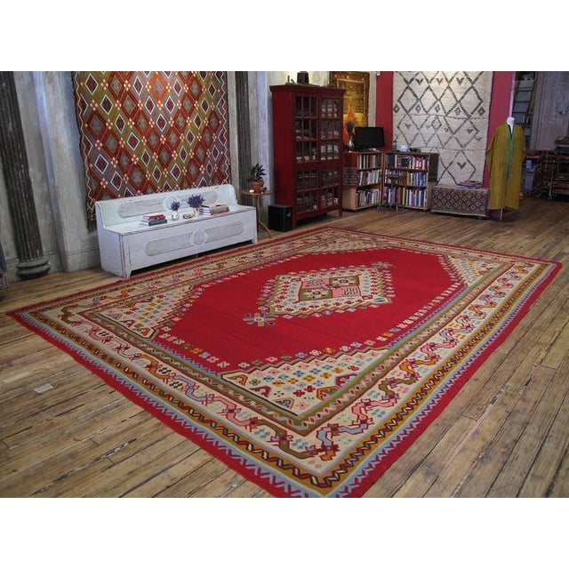 An impressive antique Turkish Kilim of large size, woven in the Oushak region of Western Turkey. In near perfect state of...