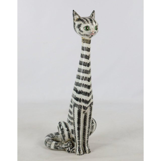 This unique Mid-Century Italian Majolica tall ceramic cat sculpture will fit in with your decor purr-fectly. The tall and...