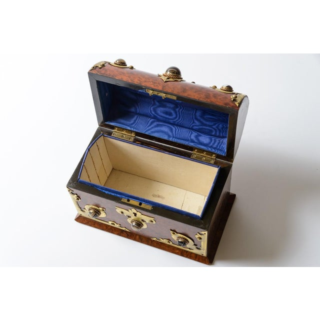 Beautiful yew wood box with stone mounts and brass accents. Fabric and paper interior.