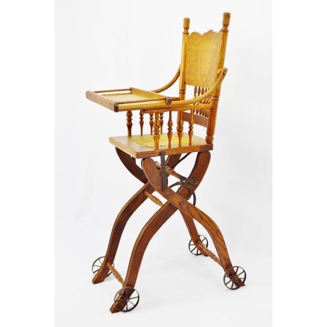 Antique Adjustable Child's High Chair and Stroller Combination- Cane Seat  Condition consistent with age and - Antique Adjustable Child's High Chair And Stroller Combination- Cane