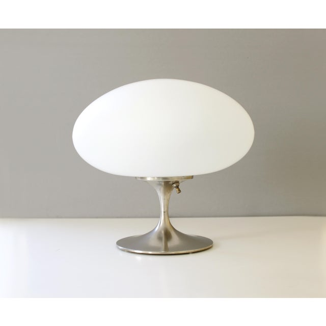 Fantastic Laurel mushroom table lamp designed by Bill Curry. Metal base with frosted glass shade. Excellent vintage...