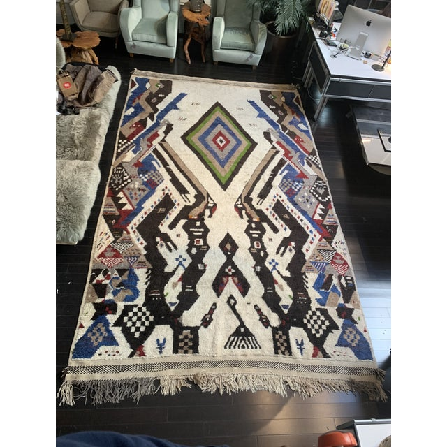 A gorgeous, large, stylish Moroccan area rug.