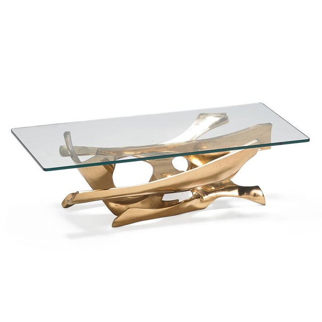 Fred Brouard (1944 - 1999). A superb sculptural coffee table by the artist and designer Fred Brouard. A gilt bronze base...